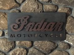 CNC plasma cut 14 gauge steel with bronze patina background and red antique finish on Indian script. #CNC plasma #Indian Motorcycle