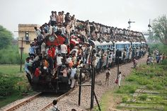 Hindu devotees travel on the roof of a train after participating in Guru Purnima Festival in Mathura, India. Guru Purnima Festival is celebrated by paying tribute to teachers by disciples or students. Follow AmiPlanet on www.pinterest.com/AmiPlanet/
