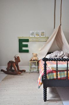 Child's room. love the wooden rocking horse//