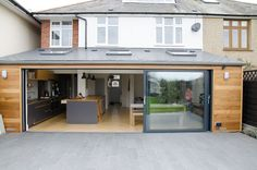 Smart Visoglide plus anthracite grey aluminium sliding doors we installed in Kent. Smart Visoglide plus anthracite grey aluminium sliding doors we installed in Kent. House Extension Plans, House Extension Design, Glass Extension, Rear Extension, Extension Ideas, Bungalow Extensions, Garden Room Extensions, House Extensions, Kitchen Extensions