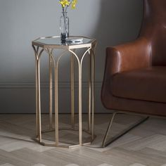 Canterbury Side Table  A unique octagonal side table with glass bevelled top in a gold finish.