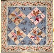 "1850 Lemoyne Star Pattern: $5 Quilt Size: 16.25"" square Block Size: 4.5"" square Rather than miter the border as we might do today, I chose an unusal 1850s approach. Much like transferware china of the 1850s, the corner blocks of the quilt do not perfectly ""register"". The stars in this project were hand stamped and hand pieced. Directions are included for rotary cutting and piecing without the hand stamping method. ."