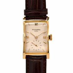 Patek Philippe refrence number 1588J manuel winding Yellow Gold case on Brown Strap, small seconds, case, dial and movement signed patek Phillipe . Moverment : Manual winding , Caliber 9L-90 , 18 jewel , Movement number 838.200, Frequency 19800 A/h Case: 18k yeloow gold case number 641.116 , diameter 30 x 23 mm Thickness 10.5 mm Dial, Ivory Dial numerals numerals with leather strap available in stock for imideadate delivery. With 6 months dover jewelry warrantee on the movement. In...