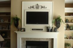 tv above decorated fireplace | tv over fireplace decorating ideas. Flat screen TV over fireplace