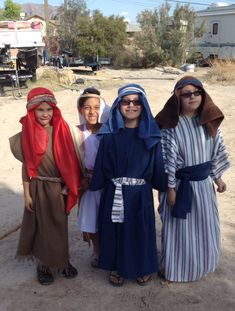 Bible costumes. Really easy to make. Used flat sheets, folded in half, cut at the fold for head to go through, it was too long so we cut the bottom & used as belts & head piece.