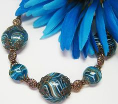 Teal Glass Brass and Copper Bracelet. $45.00, via Etsy.