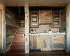 Micro wooden pallet kitchen and wall covering. Would look great in a (bigger) tiny home.
