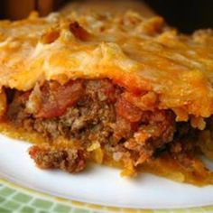 Crescent Roll TACO PIE- 1 (8 ounce) package refrigerated crescent rolls  1 pound ground beef  1 (1 ounce) package taco seasoning mix  1 (16 ounce) container sour cream  8 ounces shredded Mexican-style cheese blend  1 (14 ounce) bag tortilla chips, crushed