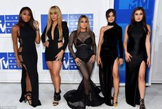 In Harmony: The ladies of Fifth Harmony flattered their curves in black...