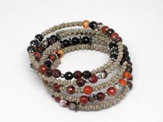 Hey, I found this really awesome Etsy listing at https://www.etsy.com/listing/114753098/fire-agate-beaded-memory-wire-bracelet