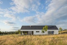 The refurbishment of a new passive-designed home in Wicklow by Patrick Lynch, completed Modern Bungalow House, Bungalow Homes, Modern House Design, Danish House, Long House, Best House Plans, House Roof, House Layouts, Modern Farmhouse