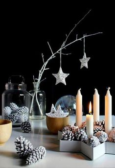 Holiday Decorating Inspiration: Scandinavian Christmas Style. Star with pinecones and candles for table