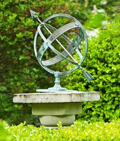 Armillary This antique astronomical device adds interest in the herb garden