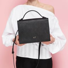 55b3534ba1 TDE MOMENTS · Chic office attire! The personalised top handle bag will  spruce up your work outfit any