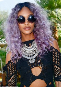 Bold: She teamed her new purple tresses with a bold playsuit, which featured cut-outs at h...