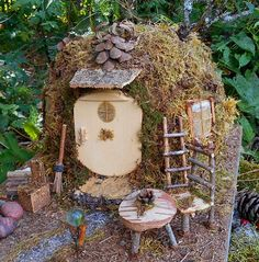 One of a kind Fairy house, This Magical Enchanted Cottage is handmade with natural materials found in the Maine woods including pine needles, moss, vines, pine cones, sticks, stones and other forest finds all mounted on reclaimed wood. It comes complete with outdoor table and chair, a stump stool, stone fireplace with firewood and a beautiful gazing ball. It has a lovely awning with a pine cone over the door, two windows, a ladder, broom and a sidewalk of crushed mica. The table, chair…