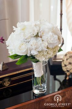 Beautiful white bouquet accented with roses and hydrangeas.