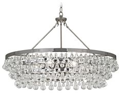 Bling Large Round Chandelier features a circular form with crystal drops. Finish available in polished nickel and deep patina bronze.  Six 75 watt, 120 volt, medium base incandescent lamps are required, but not included. General light distribution. Height is adjustable 28-65 inches. 35 inch diameter x 23.75 inch height.  Requires 70 lb junction box to hang, sold separately.