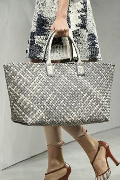 """""""Bottega Veneta's classic Cabat bag in 50 Shades of Gray. Timely, but timeless. In a dream world, it holds a towel, a book by Roberto Bolaño, and a couple of beers, and all together we're on the beach in Florida this winter."""