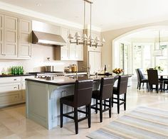 Not sure you want your cabinets to scream color? Aim for more of a whisper. This pale blue island reflects a pastel approach, which is the result of layering a creamy-white glaze over a bright blue one. The off-white cabinetry throughout the rest of the kitchen exudes a soft and welcoming energy.