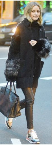 Olivia Palermo wearing a fur trim sweater, leather pants, and sneakers