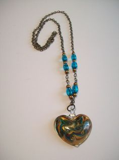 Buy Me on URCRafti.com! Boro Glass Teal, Gold & Amber Heart Pendant Necklace by Gerri Beckerman At least Pin Me so everyone can see!