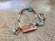 Copper Etched Bracelet bar with wrapped Crystals and glass flower wired accent bead.