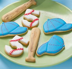 Baseball cookies~                             By cookie decorating, blue baseball cap, Brown baseball bat, white baseball number