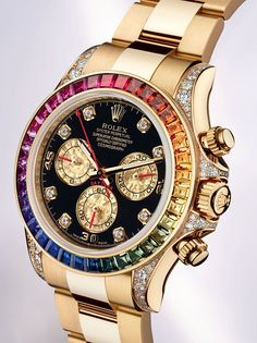 Rolex Daytona Rainbow - Yellow or white gold bands, on a 56 diamond fixed bezel set with 36 rainbow colored baguette sapphires embedded around the circumference. Yeah, it's pretty over the top, but the rainbow sapphires is an interesting concept.