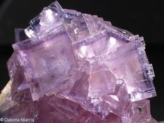 Beautiful lilac cubic crystals of Fluorite with Barite.