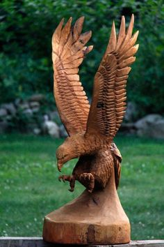 """""""How to chainsaw carve an eagle - part 1.""""  This is a great little video.  The remaining videos can be seen at his site: www.customwoodcarvings.com.  I love wood carving so much - would love to try it with a chainsaw one day - would be awesome although knowing me, I'd probably destroy it before I'd even started haha!  So for now, I think I'll stick to my little wood whittling and chisel set, hehe."""