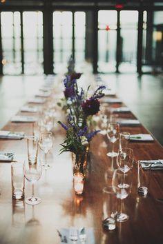 simple tables, no linens, minimal centerpieces
