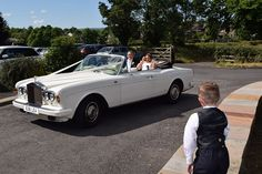 It is not often that three of Lea Cars superb wedding cars are involved in a wedding but Claire Spedding realised she needed three when planning her wedding day in September 2013 with bridegroom Danny Hooper.  On August 9thLea Cars fabulous convertible ivory Rolls Royce Corniche, driven by chauffeur Kevin, first took Danny with his mum Val, his best man brother Tony and his son Matthew aged 11 from Mytton Fold Hotel and Golf Club via the Edisford Bridge Pub to St Paul's Church in Clitheroe.