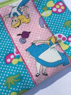 Alice in Wonderland Zipper Pouch: Mad Tea Party, Mushrooms, Clocks.