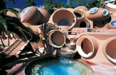 The Bubble Castle is an unusual house situated near Cannes in the South of France. It's the creation of Finnish architect Antti Lovag and known as a summer home of the legendary fashion designer Pierre Cardin. The house stretches over 1200 m2 , including 10 suites decorated by a different artists, a reception seating 350 persons, and an outdoor auditorium for 500 persons, plus 8500 m2 of garden.