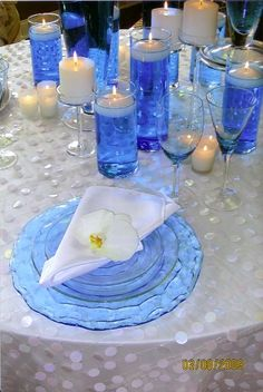 Blue & white table setting with white orchid accent