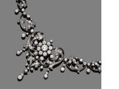 A diamond necklace/brooch/pendant, circa 1890 Set to the front with graduated pierced plaques of scrolling design, interspersed by knife-wire drops, set throughout with single, old brilliant and rose-cut diamonds, to a knife-edge back-chain accented with single-cut diamonds, mounted in silver and gold