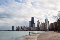 Chicago skyline winter proposal by Chicago wedding photographer Emma Mullins Photography. She said yes!!