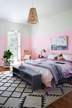 Spruce up your bedroom with a sweet pink wall.