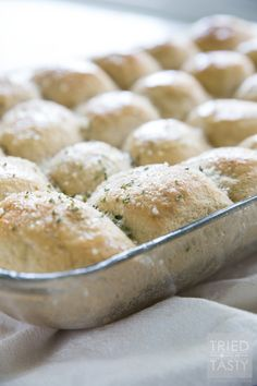 Fluffy Whole Wheat Parmesan Garlic Rolls // You haven't had a more pillowy soft whole wheat roll until you've tried this recipe! These homemade rolls are absolutely fantastic and you'll have a hard time believing they are 100% whole wheat. Great for special occasions and holidays! | Tried and Tasty http://triedandtasty.com/fluffy-whole-wheat-parmesan-garlic-rolls/
