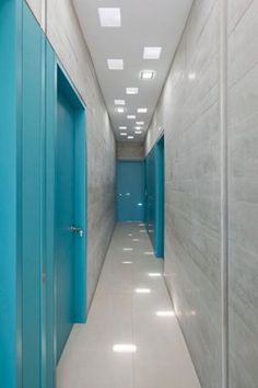 Casa Maple in Peru, Martin Dulanto Sangalli architect - turquoise doors #design #doors