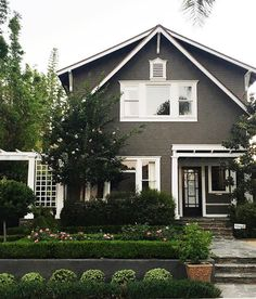I've been digging dark exteriors lately and this cute little beach house (and awesome yard) we drove by has me all  #studiomcgeeneighbors                                                                                                                                                                                 More