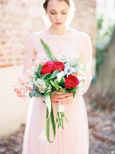 Blush orchids and red garden roses: http://www.stylemepretty.com/little-black-book-blog/2015/06/10/classically-romantic-bridal-inspiration-in-old-town-philadelphia/ | Photography: Julie Paisley - http://juliepaisleyphotography.com/