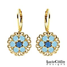 14K Yellow Gold Plated over .925 Sterling Silver Flower Shaped Dangle Earrings Designed by Lucia Costin Decorated with Blue, Light Blue Swarovski Crystals and Twisted Lines Lucia Costin. $49.00. Delicate floral design. Unique and feminine, perfect to wear for special occasions and evenings. Beautifully designed with sapphire and aquamarine Swarovski crystals. Lucia Costin dangle earrings. Produced delicately by hand, made in USA