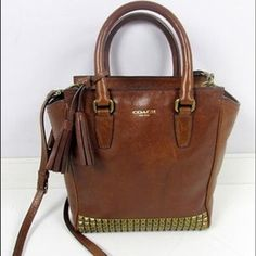 Coach Legacy Studded Mini Tanner Saddle Brown Never used! Received as a gift so there is no tag but care card is still in the inside pocket. Perfect condition, just not my style! Needs a good home to the right fashionista  It is a mini so measures about 9in x 8.5 in x 3.5 in. Coach Bags Crossbody Bags