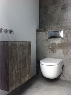 Wall mounted, floating bathroom fixtures given extra solidity and permanance with the use of concrete