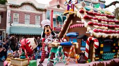 """Goofy decorates a gingerbread house on a float in Disneyland's """"A Christmas Fantasy Parade."""" The parade is a tradition in the park and travels down Main Street USA to celebrate the holidays."""