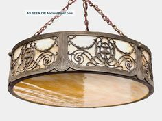 Art Nouveau American Cameo Glass And Spelter Ceiling Light.  From http://ancientpoint.com/inf/6485-art_nouveau_american_cameo_glass_and_spelter_ceiling_light.html