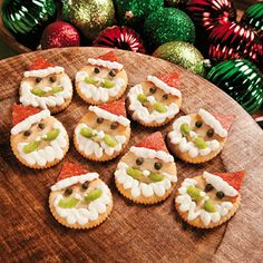 Christmas Santa Crackers - These delicious appetizers may have you believing in Santa Claus all over again.(butter cackers, pepperoni slices, ricotta cheese, capers, celery)