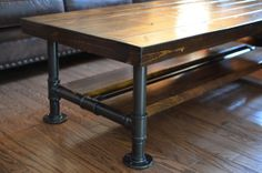 "Industrial Knotty Pine Coffee Table with Steel Pipe Legs with Lower Wood Shelf. Top 18""W x 36"" L x 18"" T on Etsy, $249.00"